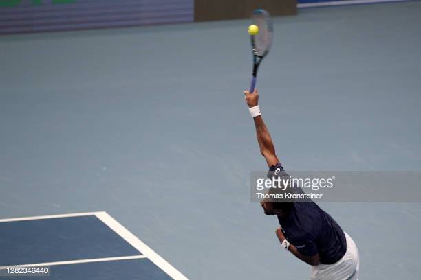 Gael Monfils of France serves during his match against Pablo Carreno Busta of Spain during day three of the Erste Bank Open tennis tournament at...