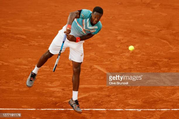 Gael Monfils of France serves during his Men's Singles first round match against Alexander Bublik of Kazakhstan on day two of the 2020 French Open at...
