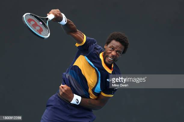 Gael Monfils of France serves in his Men's Singles first round match against Emil Ruusuvuori of Finland during day one of the 2021 Australian Open at...