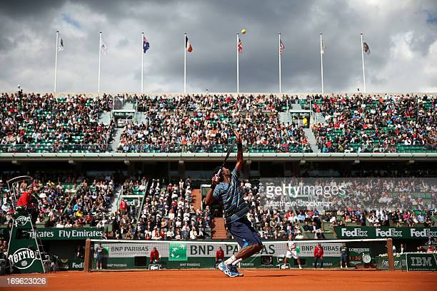 Gael Monfils of France serves in his Men's Singles match against Ernests Gulbis of Latvia during day four of the French Open at Roland Garros on May...