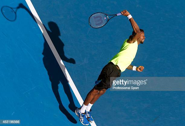 Gael Monfils of France serves in his second round match against Yen-Hsun Lu of Chinese Taipei during day four of the 2013 Australian Open at...