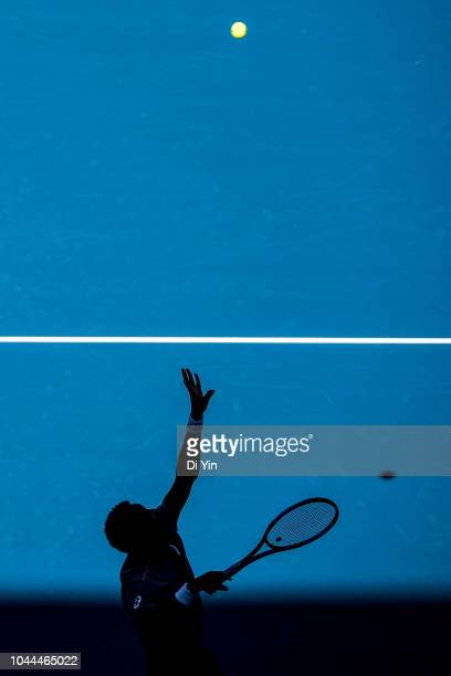 Gael Monfils of France serves to Fernando Verdasco of Spain during his Men's Singles first Round match of the 2018 China Open at the China National...
