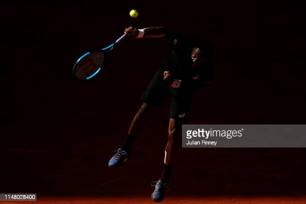 Gael Monfils of France serves to Roger Federer of Switzerland during day six of the Mutua Madrid Open at La Caja Magica on May 09 2019 in Madrid Spain