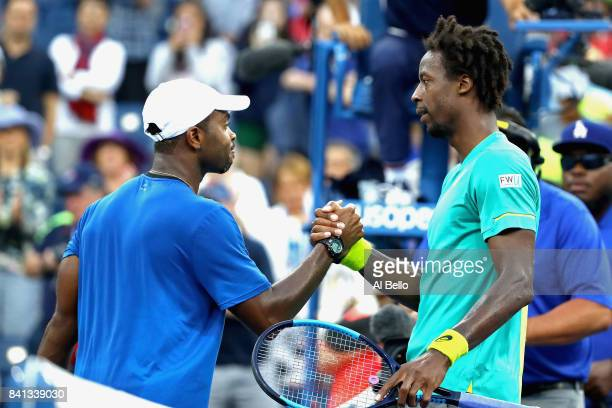 Gael Monfils of France shakes hands after defeating Donald Young of the United States during their second round Men's Singles match on Day Four of...