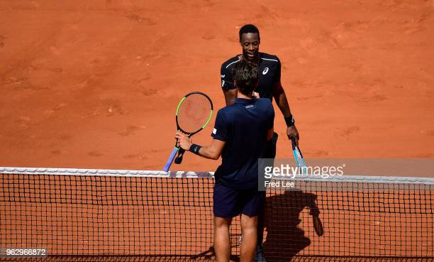 Gael Monfils of France shakes hands with Elliot Benchetrit of France men's singles first round match during day one of the 2018 French Open at Roland...