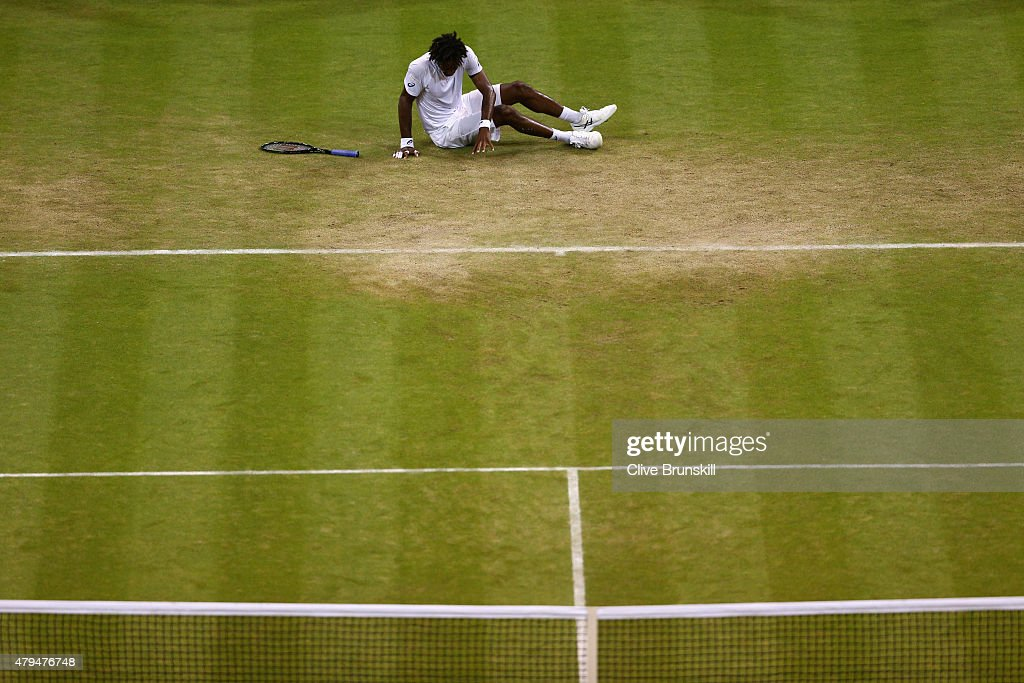 Gael Monfils of France slips on the grass after defeat in his Mens Singles Third Round match against Gilles Simon of France during day six of the Wimbledon Lawn Tennis Championships at the All England Lawn Tennis and Croquet Club on July 4, 2015 in London, England.
