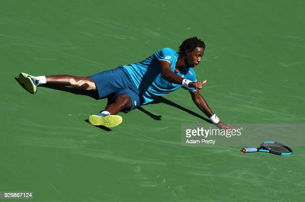 Gael Monfils of France slips over after playing a shot during his match against Matthew Ebden of Australia during the BNP Paribas Open at the Indian...
