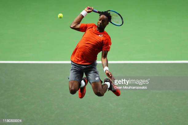 Gael Monfils of France smashes a forehand return as he jumps in the air to Stan Wawrinka of Switzerland in their Mens Final during Day 7 of the ABN...