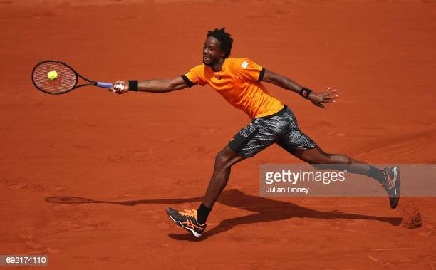 Gael Monfils of France stretches for a forehand in his men's singles third round match against Richard Gasquet of France during day eight of the...