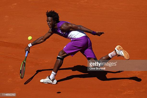 Gael Monfils of France stretches to hit a forehand during the men's singles round two match between Guillaume Rufin of France and Gael Monfils France...