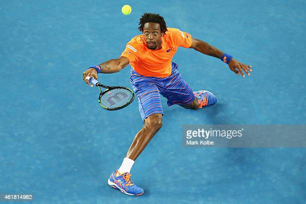 Gael Monfils of France stretches to play a shot in his first round match against Lucas Pouille of France during day two of the 2015 Australian Open...