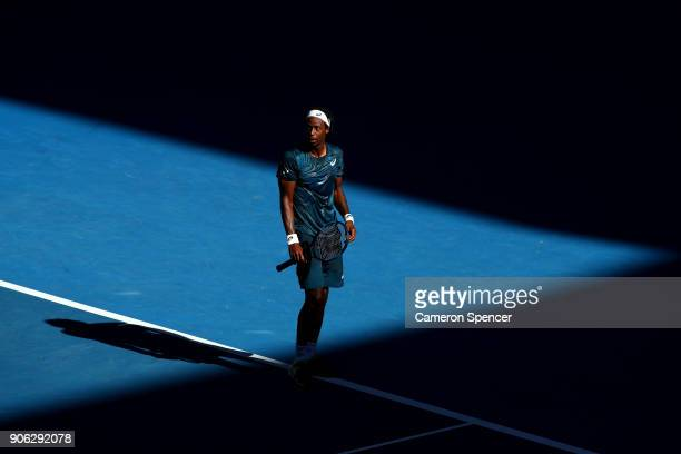 Gael Monfils of France struggles with the heat during his second round match against Novak Djokovic of Serbia on day four of the 2018 Australian Open...