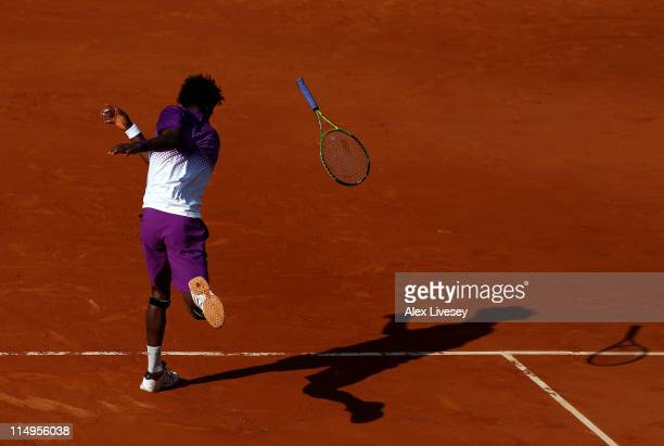 Gael Monfils of France throws his racquet to the court in frustration during the men's singles quarterfinal match between Gael Monfils of France and...