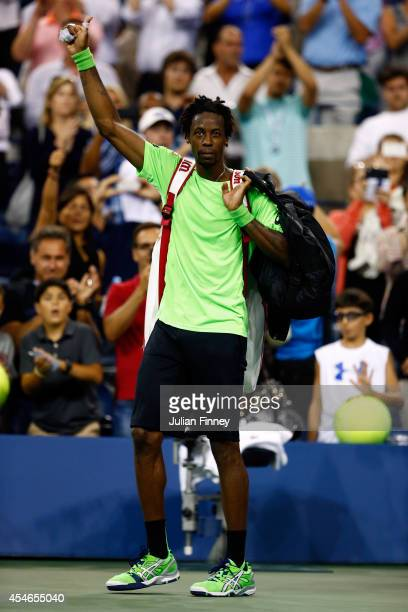 Gael Monfils of France waves to the crowd after being defeated by Roger Federer of Switzerland in their men's singles quarterfinal match on Day...