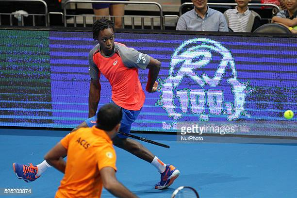 Gael Monfils of the Indian Aces hits a between the legs return to Nick Kyrgios and Tomas Berdych of the Singapore Slammers during their doubles match...