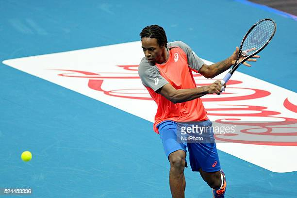 Gael Monfils of the Indian Aces makes a backhand return to Lleyton Hewitt of the Singapore Slammers during their singles match at the International...