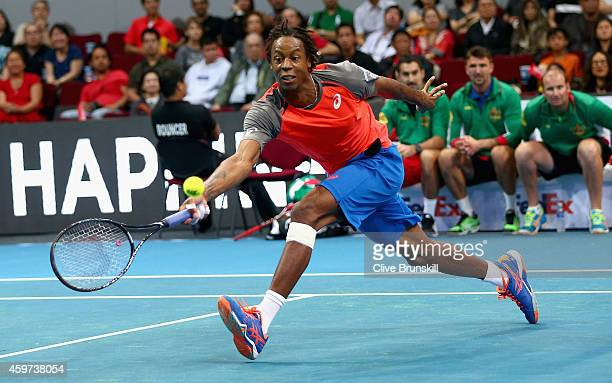 Gael Monfils of the Indian Aces plays a forehand volley against replacement player Malik Jaziri of Tunisia during the Coca-Cola International Premier...