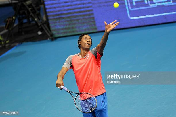 Gael Monfils of the Indian Aces serves to Lleyton Hewitt of the Singapore Slammers during their singles match at the International Premier Tennis...