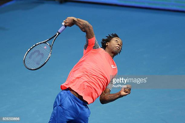 Gael Monfils of the Indian Aces serves to Nick Kyrgios and Tomas Berdych of the Singapore Slammers during their doubles match at the International...