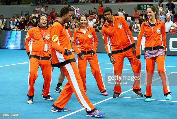 Gael Monfils of the Indian Aces teaches his team mates to dance after their victory against the UAE Royals during the Coca-Cola International Premier...