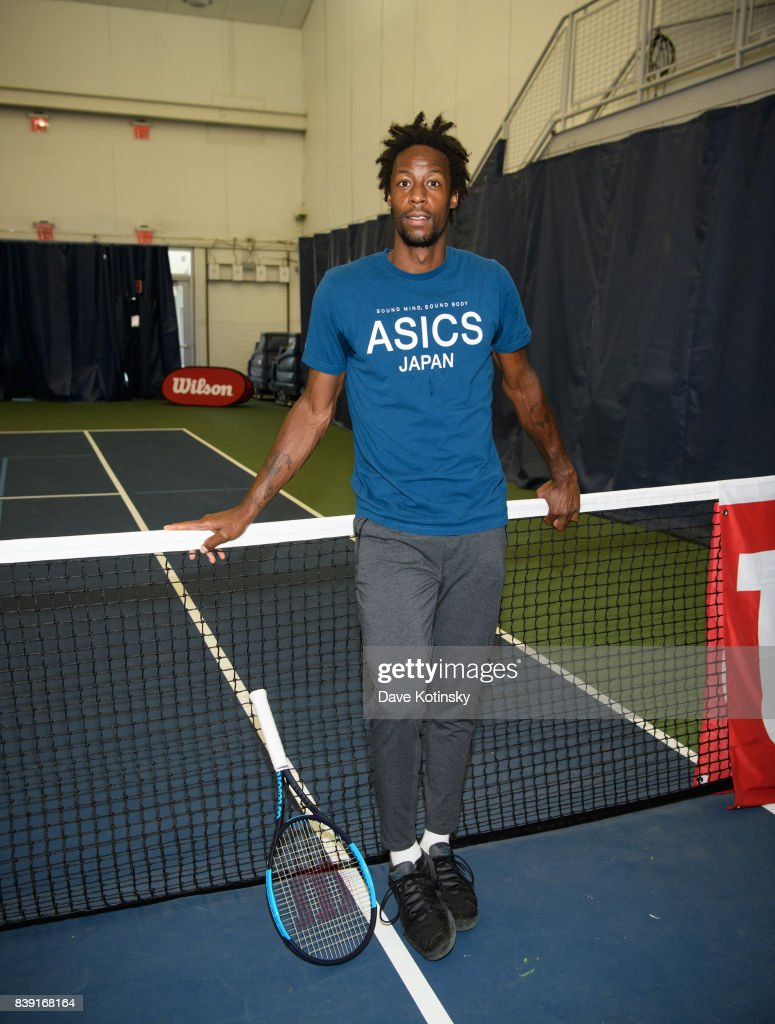 Gael Monfils surprises and join unsuspecting fans for A few games on court fans at Arthur Ashe Stadium on August 25, 2017 in New York City.