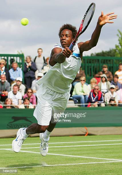Gael Montfils of France dives to hit a backhand during the Men's Singles second round match against Kristof Vliegen of Belgium during day four of the...
