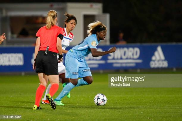 Gaelle Enganamouit of Avaldsnes and Saki Kumagai of Lyon and Isobel Christiansen of Lyon during the Women's Champions League match between Lyon and...