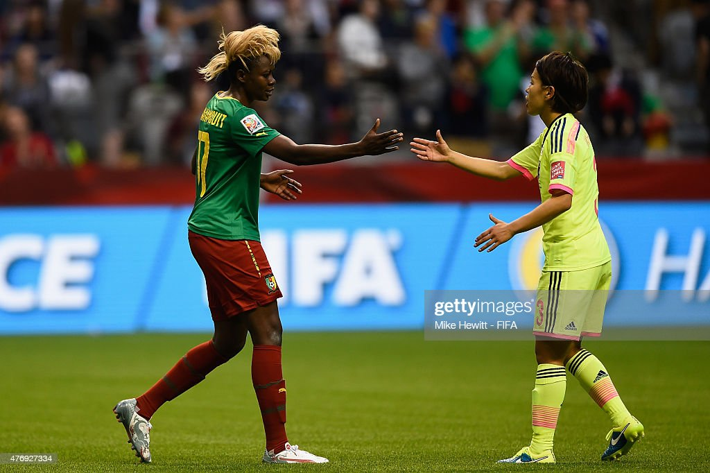 Gaelle Enganamouit of Cameroon and Azusa Iwashimizu of Japan shake hands after the FIFA Women's World Cup 2015 Group C match between Japan and Cameroon at BC Place Stadium on June 12, 2015 in Vancouver, Canada.