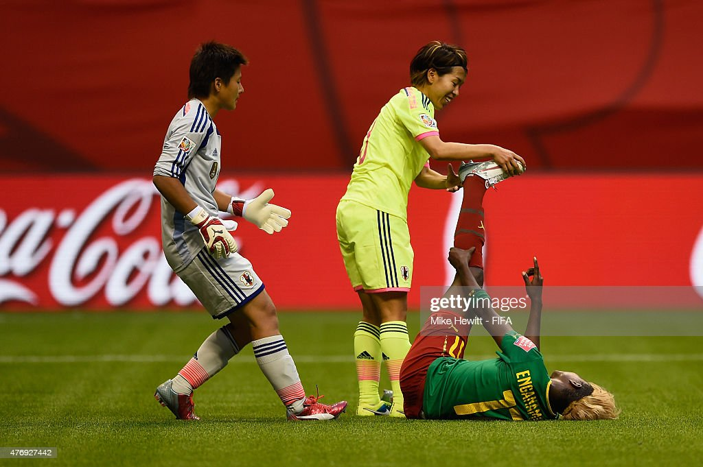 Gaelle Enganamouit of Cameroon Gaelle Enganamouit of Cameroon is sportingly treated for cramp by Azusa Iwashimizu of Japan during the FIFA Women's World Cup 2015 Group C match between Japan and Cameroon at BC Place Stadium on June 12, 2015 in Vancouver, Canada.