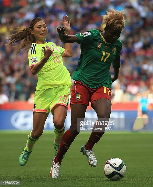 Gaelle Enganamouit of Cameroon holds off Rumi Utsugi of Japan during the FIFA Women's World Cup 2015 Group C match between Japan and Cameroon at BC...
