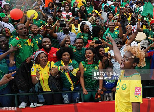 Gaelle Enganamouit of Cameroon leads her team in a cheer with their fans following their 21 win over Switzerland following the Women's World Cup 2015...