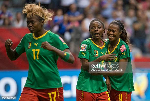 Gaelle Enganamouit of team Cameroon Ajara Nchout of team Cameroon and Yvonne Leuko of team Cameroon celebrate a goal in their 21 loss to Switzerland...