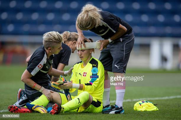Gaelle Thalmann of Switzerland receives treatment from the medical team during the UEFA Women's Euro 2017 Group C match between Iceland and...
