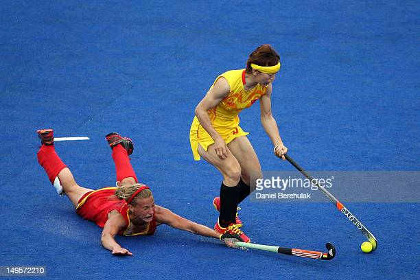Gaelle Valcke of Belgium slips as she challenges Baorong Fu of China during the Women's Hockey Match between Belgium and China on day 4 of the London...
