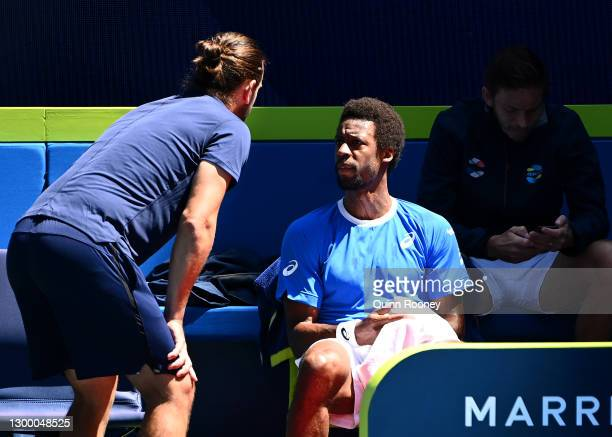 GaelMonfils of France talks to a team mate in his Group C singles match against MatteoBerrettini of Italy during day two of the 2021 ATP Cup at...
