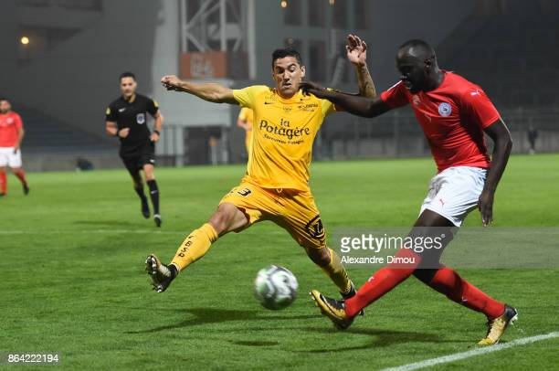 Gaetan Belaud of Brest and Sada Thioub of Nimes during the Ligue 2 match between Nimes Olympique and Stade Brestois at on October 20 2017 in Nimes...