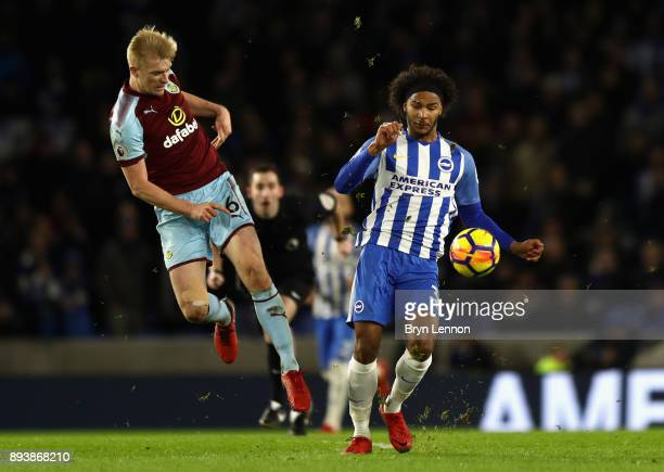 Gaetan Bong of Brighton and Hove Albion and Ben Mee of Burnley battle for posession during the Premier League match between Brighton and Hove Albion...