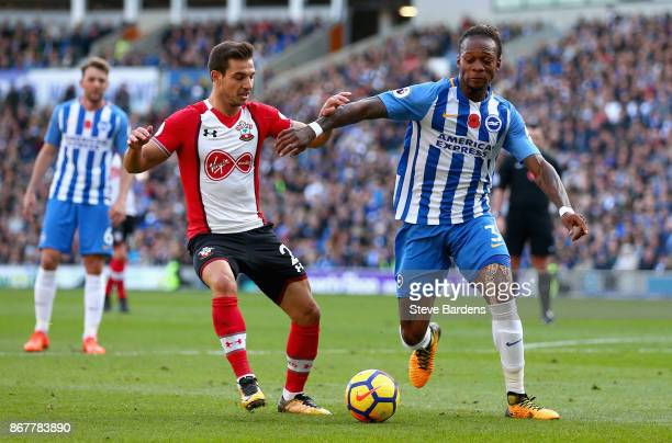 Gaetan Bong of Brighton and Hove Albion and Cedric Soares of Southampton battle for the ball during the Premier League match between Brighton and...