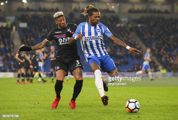 Gaetan Bong of Brighton and Hove Albion and Patrick van Aanholt of Crystal Palace battle for the ball during The Emirates FA Cup Third Round match...