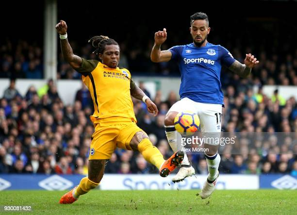 Gaetan Bong of Brighton and Hove Albion challenges Theo Walcott of Everton during the Premier League match between Everton and Brighton and Hove...