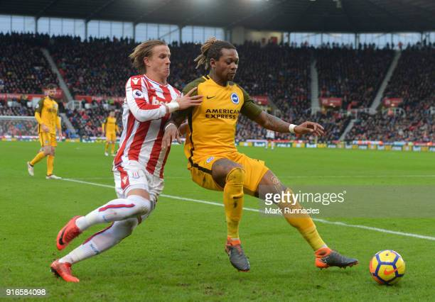 Gaetan Bong of Brighton and Hove Albion holds off Moritz Bauer of Stoke City during the Premier League match between Stoke City and Brighton and Hove...
