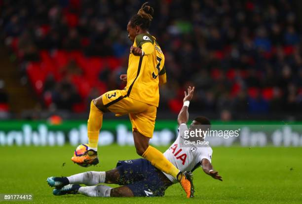 Gaetan Bong of Brighton and Hove Albion is tackled by Serge Aurier of Tottenham Hotspur during the Premier League match between Tottenham Hotspur and...