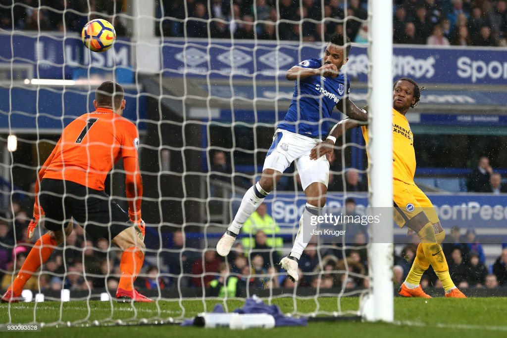 Gaetan Bong of Brighton and Hove Albion scores a own goal for Everton's first goal during the Premier League match between Everton and Brighton and Hove Albion at Goodison Park on March 10, 2018 in Liverpool, England.