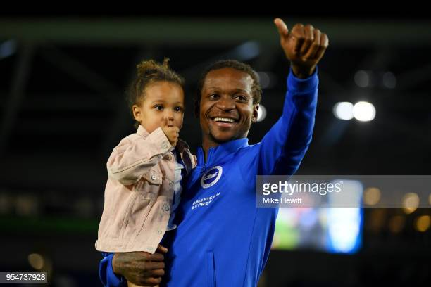 Gaetan Bong of Brighton Hove Albion celebrates on the pitch after the Premier League match between Brighton and Hove Albion and Manchester United at...