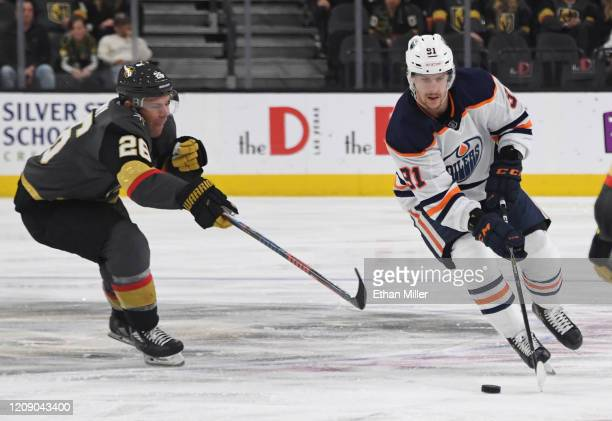 Gaetan Haas of the Edmonton Oilers skates with the puck against Paul Stastny of the Vegas Golden Knights in the third period of their game at TMobile...