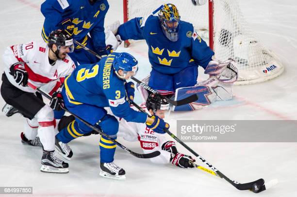 Gaetan Haas vies with John Klingberg during the Ice Hockey World Championship Quarterfinal between Switzerland and Sweden at AccorHotels Arena in...