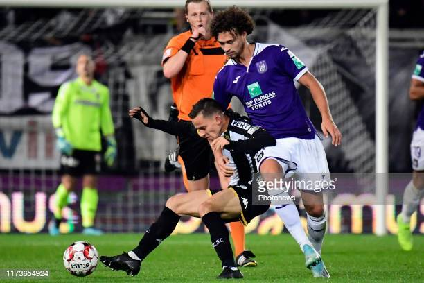 Gaetan Hendrickx midfielder of Charleroi battles for the ball with Philippe Sandler defender of Anderlecht during the Jupiler Pro League match...