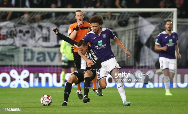Gaetan Hendrickx of Charleroi battles for the ball with Philippe Sandler of Anderlecht during the Jupiler Pro League match between Sporting Charleroi...