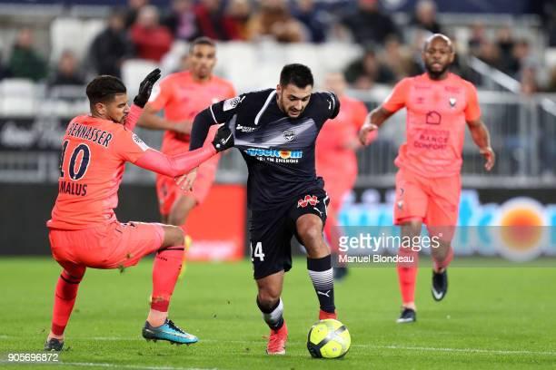 Gaetan Laborde of Bordeaux and Youssef Ait Bennasser of Caen during the Ligue 1 match between FC Girondins de Bordeaux and SM Caen at Stade Matmut...