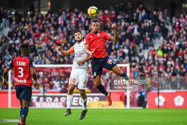 Gaetan Laborde of Montpellier and Gabriel Dos Santos Magalhaes of Lille during the Ligue 1 match between Lille and Montpellier at Stade Pierre Mauroy...